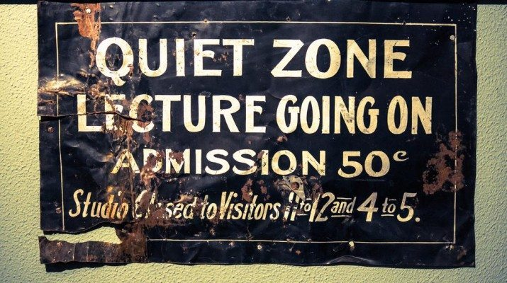 Old sign saying 'Quiet Zone, Lecture going on'