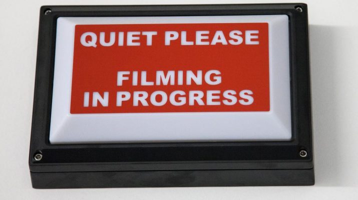 filming in progress sign