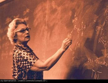 woman writing on blackboard