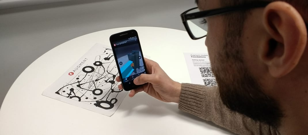 smartphone with Augment app pointed at the tracker to display the augmented reality model