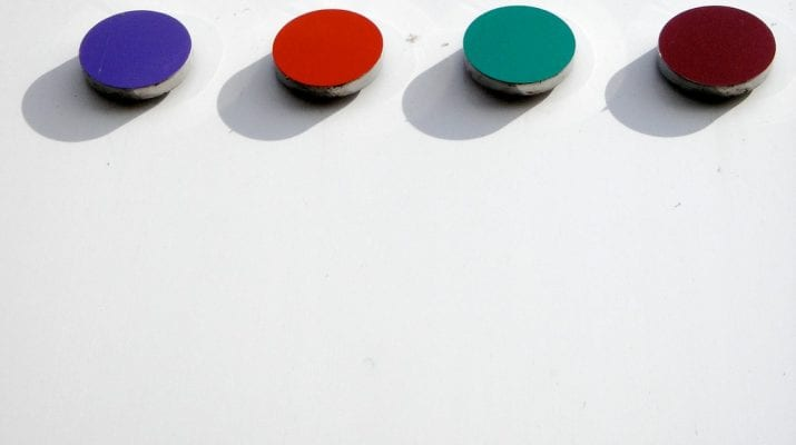 Four buttons on a white background: one purple, one red, one green and one brown.