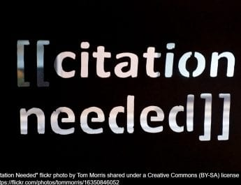 Photograph of a plaque reading '[[citation needed]]'